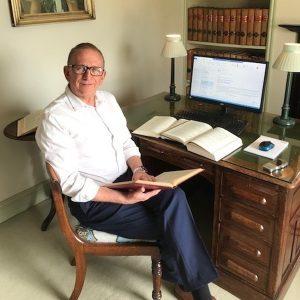 Mark Adcock reading a book